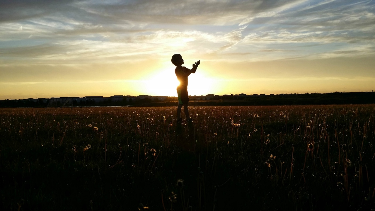 memories-young-boy-sunset-silhouette