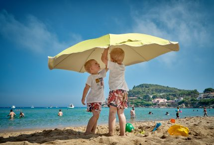 two-boys-playing-beach-umbrella